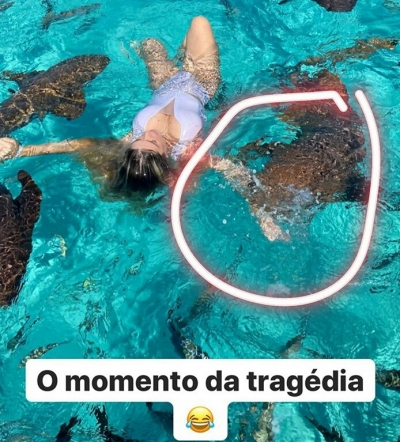 Influencer é mordida por tubarão ao tirar foto no mar