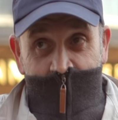 Homem é multado ao cobrir rosto