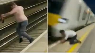 Bêbado pula em trilho de ferrovia de Londres antes de trem passar