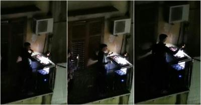 DJ faz apresentaçao na varanda para vizinhos de quarentena