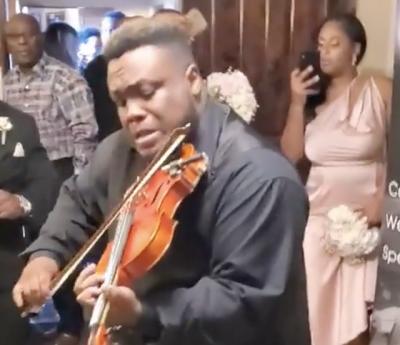 Violinista se anima um pouco demais em casamento